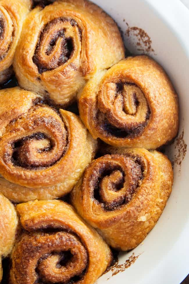Cinnamon Rolls with Gingerbread Cream Cheese Frosting - The perfect Christmas morning breakfast! Turn those crescent rolls into a super easy, but decadent treat.