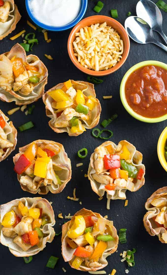 Chicken Fajita Wonton Cups - A little East, a little West. These appetizer cups are perfect for entertaining with a festive Mexican filling in a crunchy wonton.