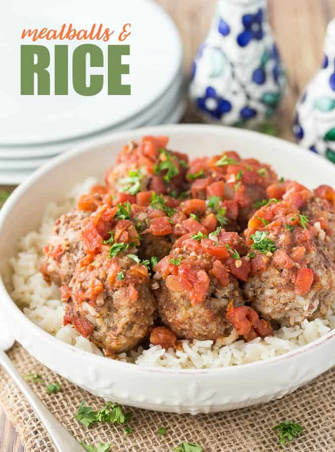 Meatballs & Rice - These simple beef meatballs are served with a spiced tomato sauce over a bed of rice. There's rice in the meatballs too for the fluffiest texture!