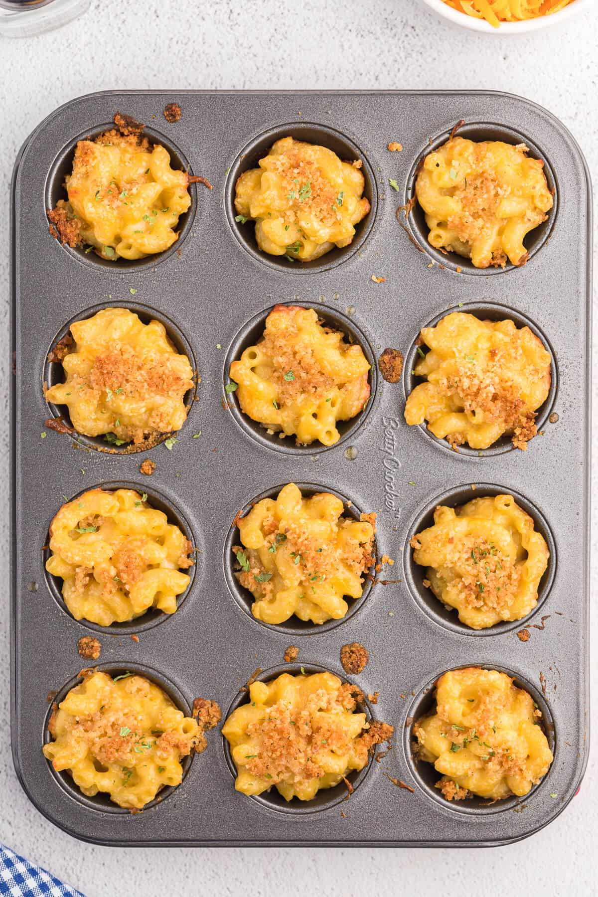 Mac and Cheese Cups - Comfort food in a cup! The perfect cozy, cheesy side dish, but handheld for appetizers and tailgating.