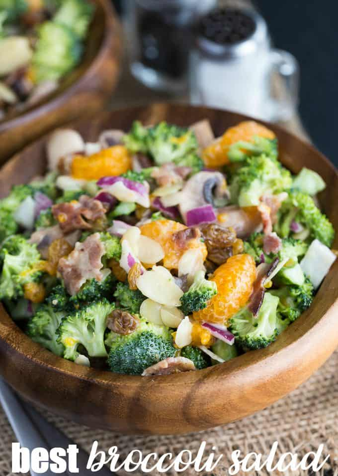 Best Broccoli Salad - Full of fresh, vibrant broccoli, raisins, sliced almonds, mushrooms and sweet mandarin oranges topped with a sweet, creamy dressing. This broccoli salad recipe is both hearty and filling!