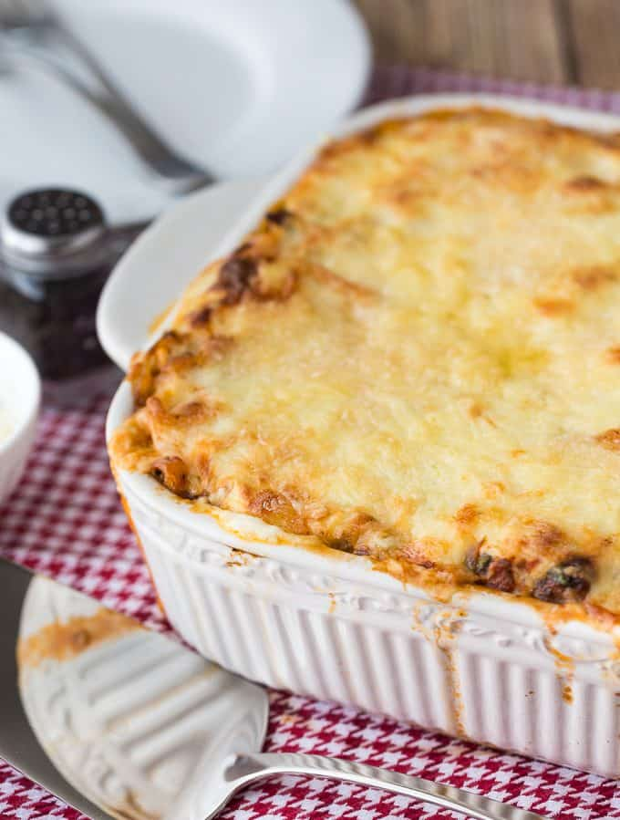 Spaghetti Bake - A comforting casserole made with spicy Italian sausage, veggies and rich, creamy cheese sauce. This recipe is my mom's fave!