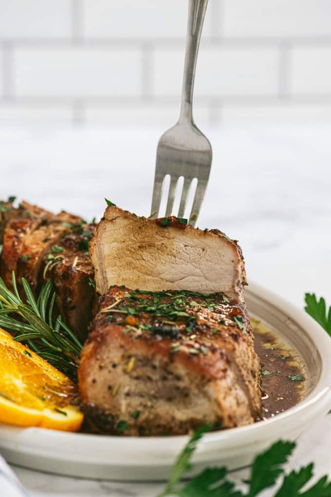 Orange Mustard Pork Tenderloin - This easy glazed tenderloin recipe is sweet and savory with orange juice and stone ground mustard. You'll never have a dry piece of pork with this homemade marinade.