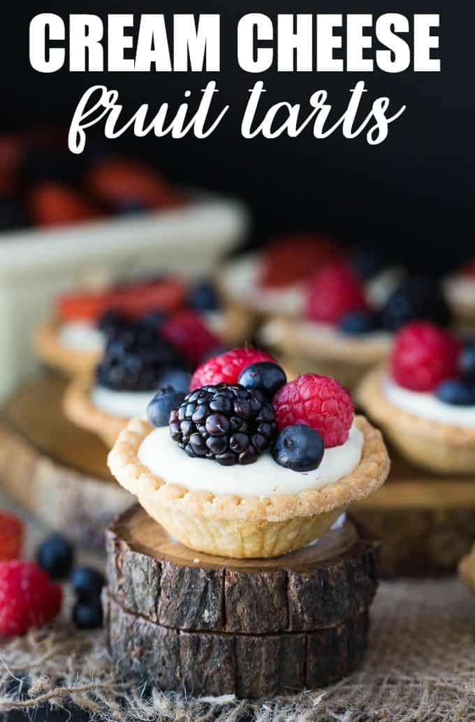 Cream Cheese Fruit Tarts - A sweet and vibrant way to dress up your party's dessert table! These decadent treats won't last long.
