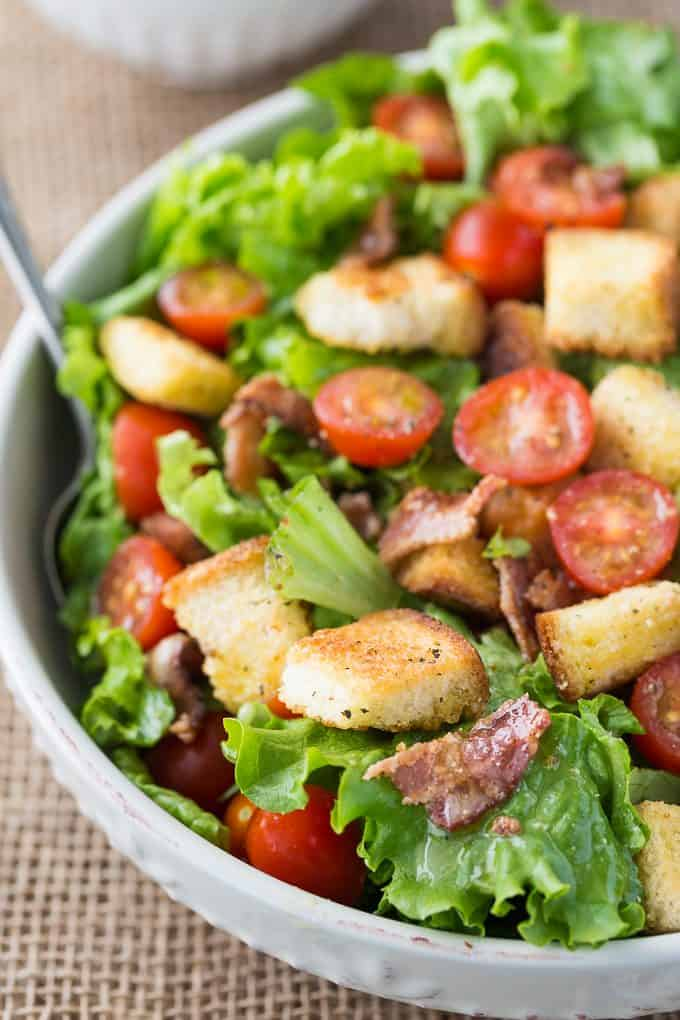 BLT Salad - Try your favourite sandwich as a salad! You'll love the fresh lettuce, juicy tomatoes and crisp bacon topped with savoury croutons and Honey Dijon Vinaigrette.
