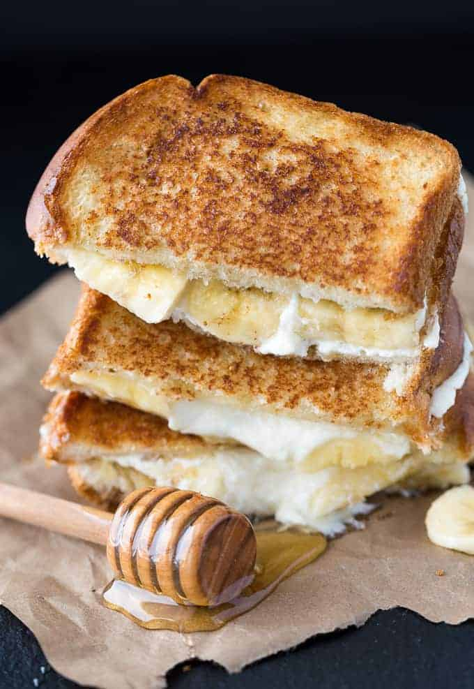 Honey Banana Grilled Cheese Sandwich - Perfect for breakfast or dessert! The perfect sweet grilled cheese sandwich with mascarpone cheese and sliced bananas.