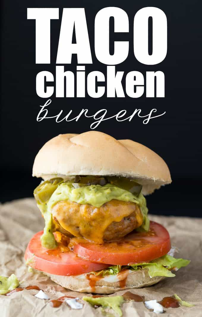 Taco Chicken Burgers - Switch it up for Mexican night! These healthier oven-baked chicken burgers are made with taco seasoning and topped with guacamole, jalapenos, and of course, cheese.