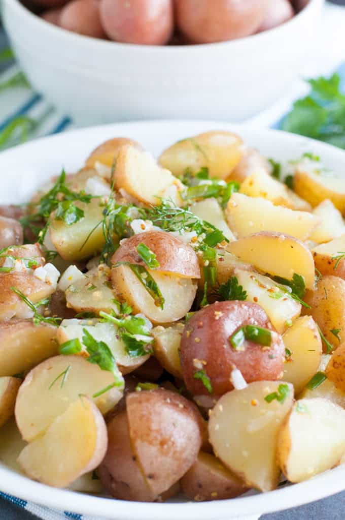 Herb Potato Salad - Fresh herbs and potatoes join forces to make this flavorful herb potato salad. Perfect for any gathering, pot-luck or the ultimate side dish.