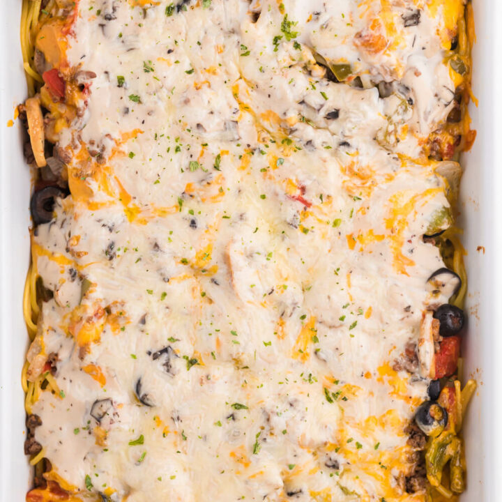Spaghetti Casserole - Layered pasta, creamy mushroom sauce, diced tomatoes, mushrooms and olives are combined to make a perfect weekend supper.