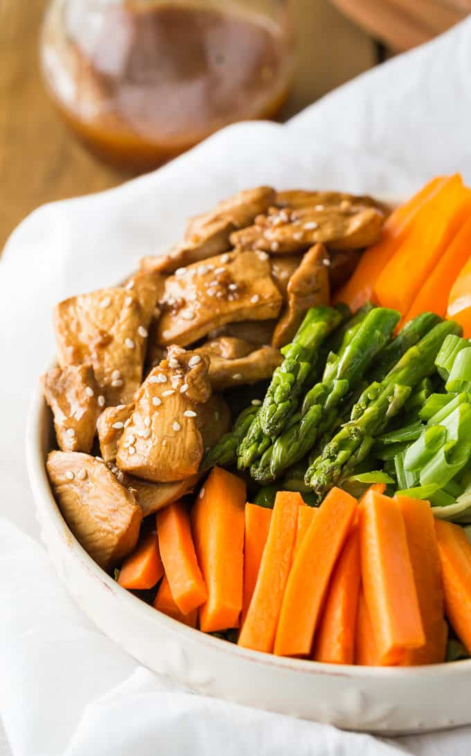 Chicken & Asparagus Salad - A delicious spring salad packed with veggies, seasoned chicken and a tangy Sesame Ginger dressing.