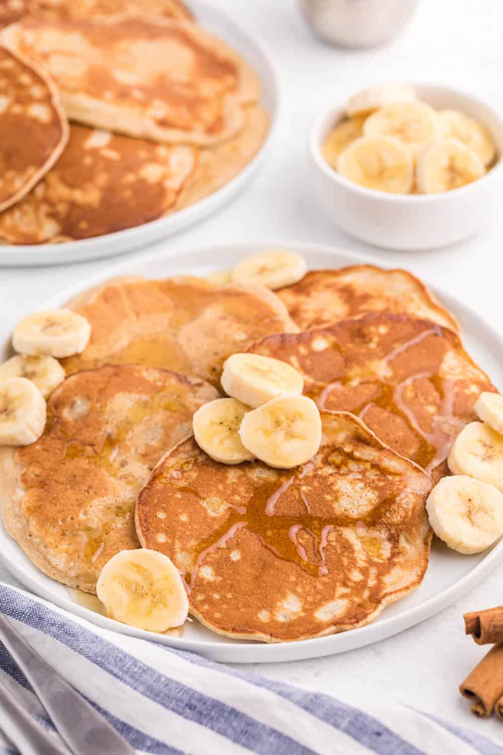 Cinnamon Banana Pancakes - Add some cinnamon and bananas to your next batch of pancakes. My family gobbled this delicious breakfast up in record time!