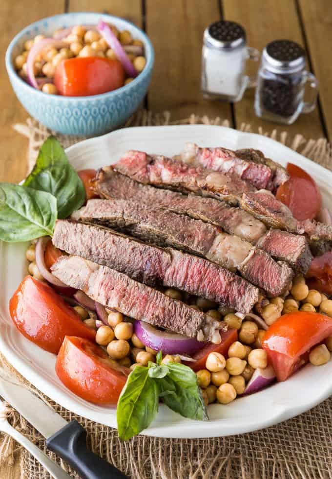 Mediterranean Style Grilled Rib Steak - Tender, juicy rib steak is sliced and nestled in with a fresh garbanzo bean salad.
