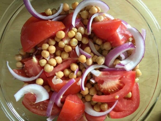 Mediterranean Style Grilled Rib Steak - Tender, juicy rib steak is sliced and nestled in with a fresh garbanzo bean salad.