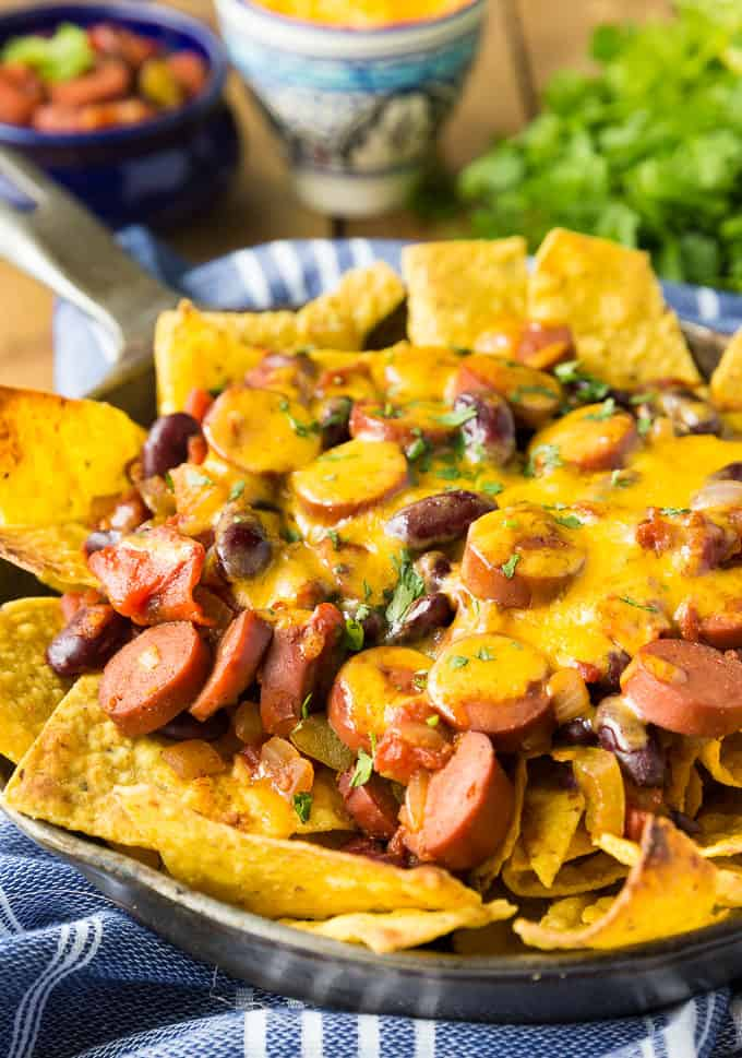 Spicy Chili Nachos - A little heat and a lot of flavor! Spice up your party with this mash-up appetizer of chili dogs and crunchy nachos.