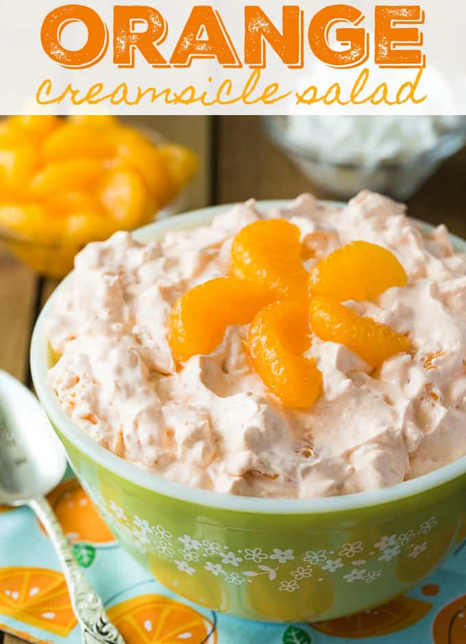 Orange Creamsicle Salad - Sweet, creamy, fluffy and oh so good! This old-fashioned recipe will be a hit at your family's dinner table.