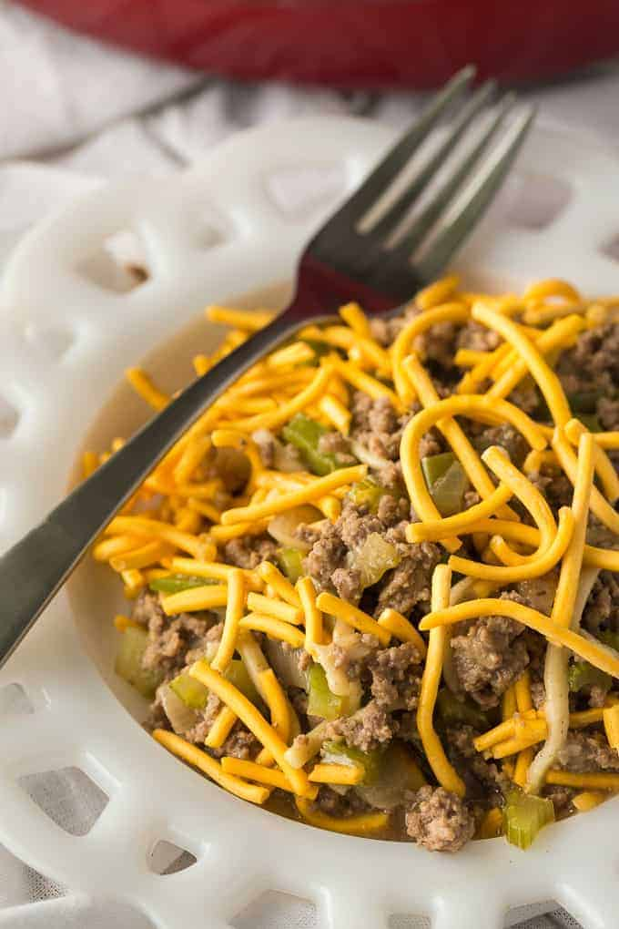 Chow Mein Skillet - A one-pot meal topped with a delightful crunch! This beef and peppers main dish is covered with traditional Chinese noodles for a new and exciting weeknight dinner.