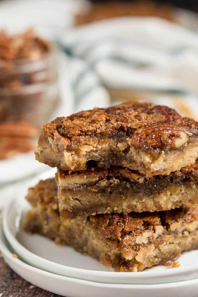 Maple Pecan Squares - Ooey gooey YUM! This easy bar recipe is a cross between a butter tart and pecan pie. Prepare to lick your fingers from this mouthwatering dessert.