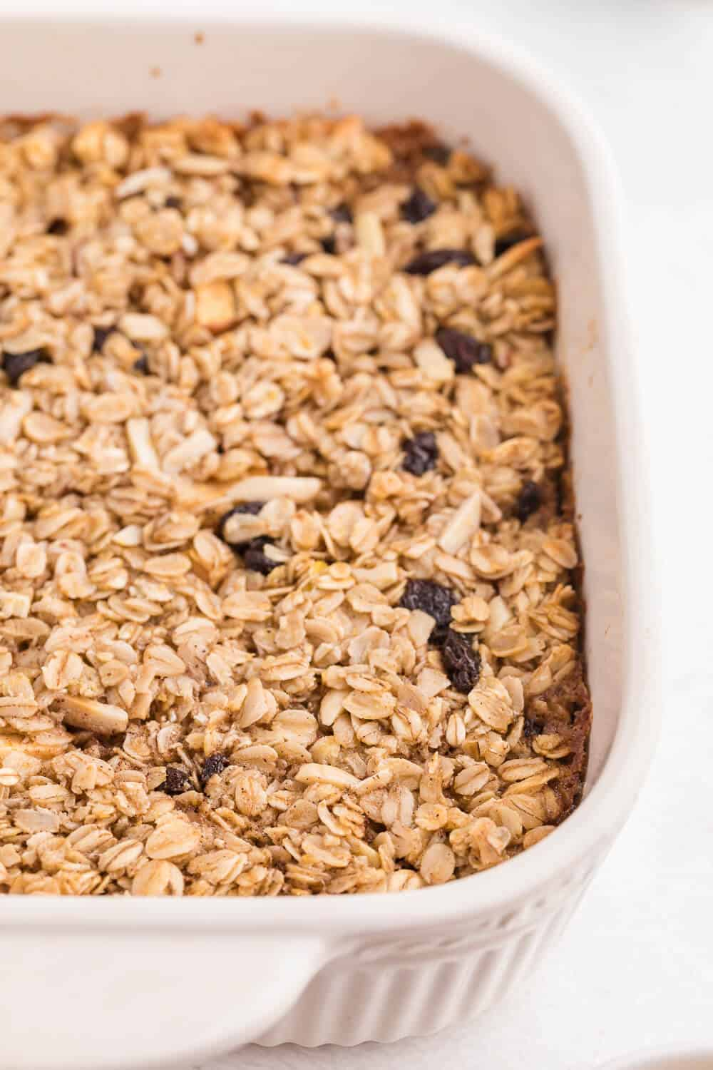 Oatmeal Casserole - This baked oatmeal is hearty, warm and filling. Loaded with apples, raisins and almonds, or whatever your favourite additions are, the whole family is sure to enjoy it!