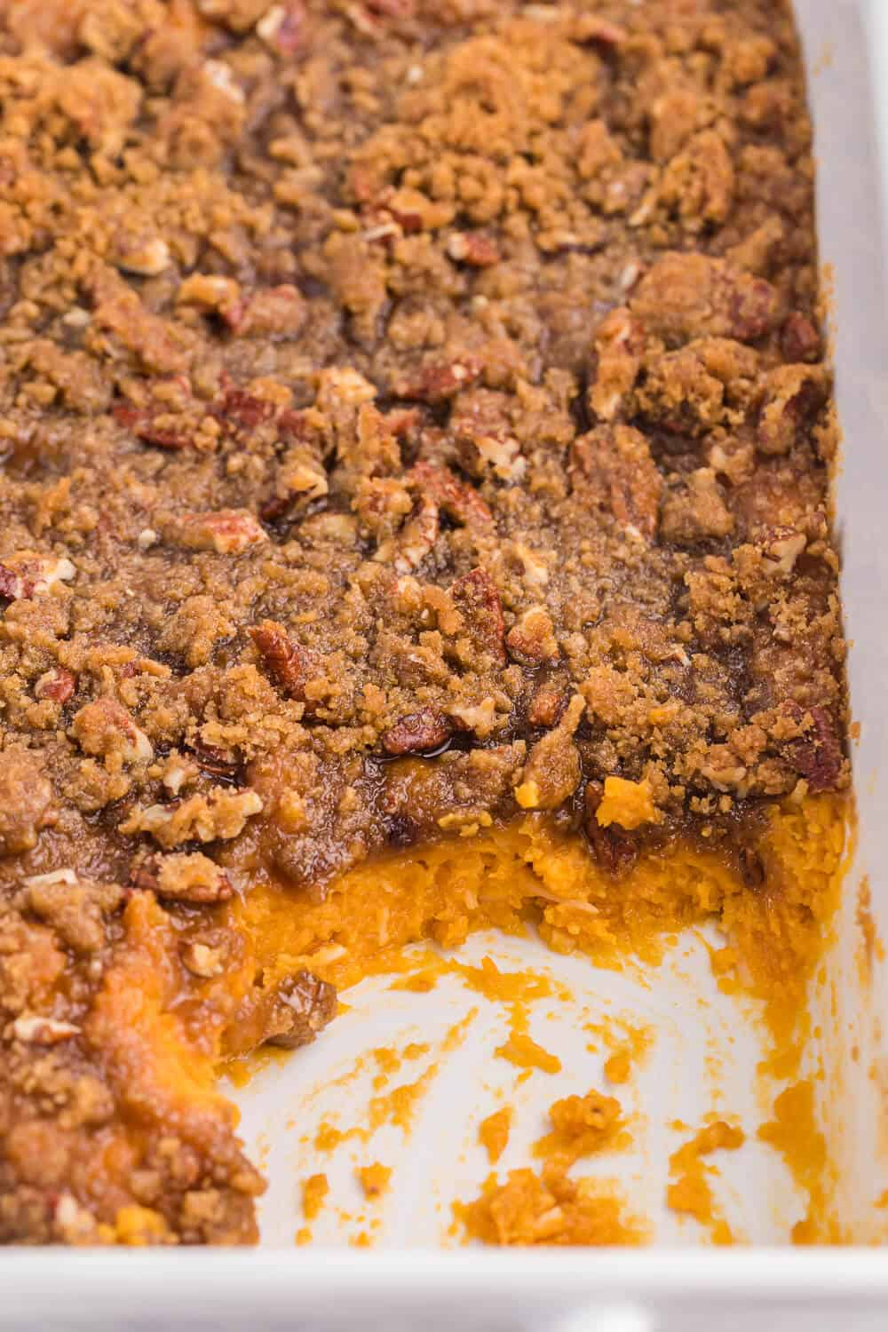 Sweet Potato casserole with pieces served out of it
