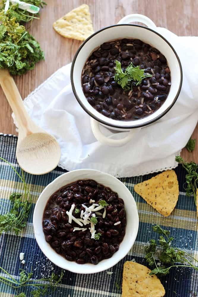 Serve up these easy Slow Cooker Black Beans! A gluten free and vegetarian recipe that is so simple to make. If you want to cook dried black beans this recipe is perfect for you.