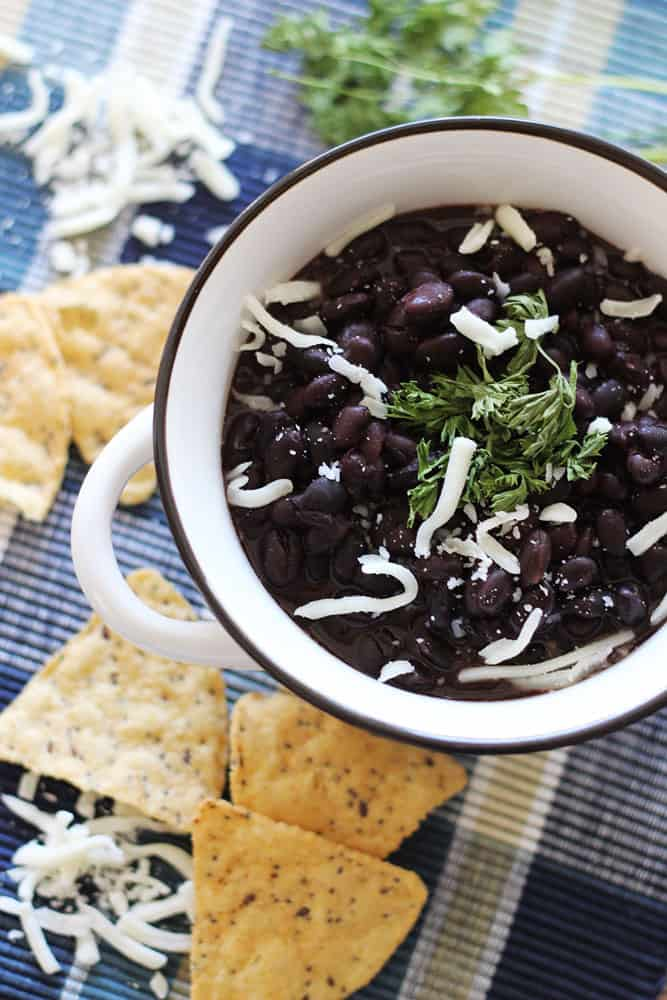 Slow Cooker Black Beans - Black beans are so versatile. You can serve them with rice, as a dip for chips or as a side dish to any meal! And these Black Beans are fool proof because the slow cooker does all the work!