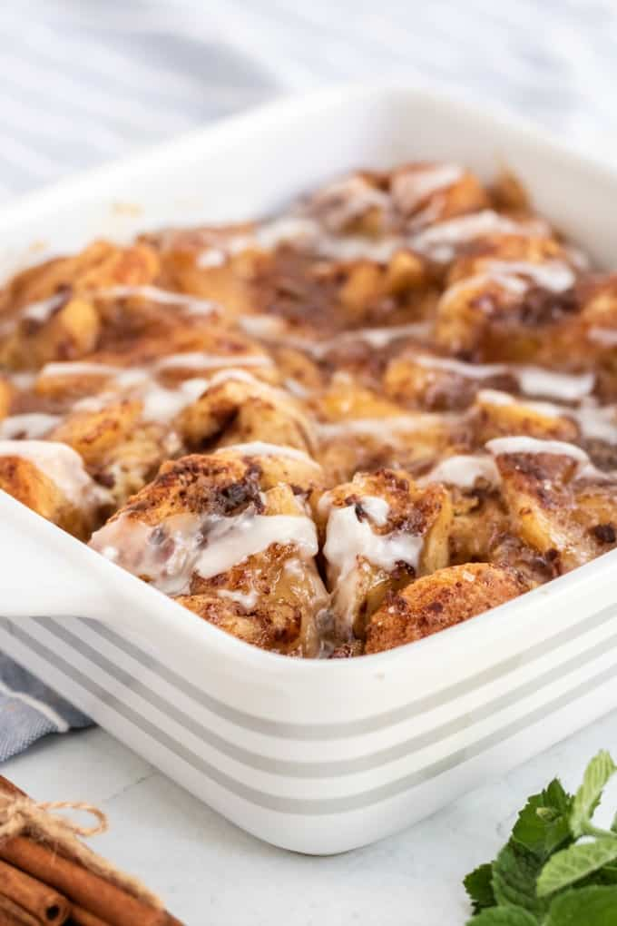 Apple Cinnamon Bun Breakfast Casserole - A sweet way to start your day and feed your guests! It's made with cinnamon buns + apple pie filling for a mouthwatering breakfast casserole you'll make again and again.