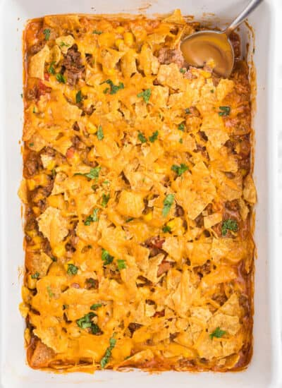Beef Nacho Bake - This beefy nacho casserole is a welcome change from the traditional Taco Night. It hits all the right notes with cheese, beef, salsa and crunchy tortilla chips.