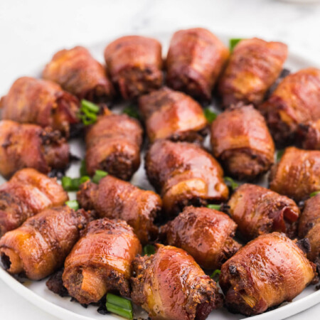 Stuffed Bacon Rolls - A great party appetizer! Smoky bacon wrapped around juicy meatballs for a meaty snack.