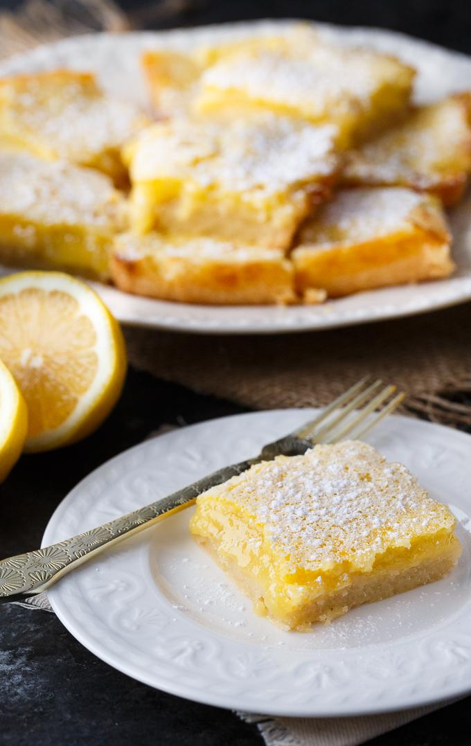 Lemon Bars - This easy lemon dessert will practically melt in your mouth!