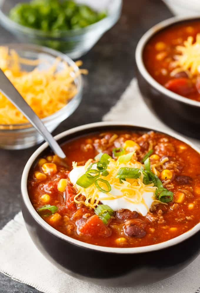 Taco Chili - The best Taco Tuesday recipe for soup season! Make this chunky taco soup with black beans, corn, green chiles, and a dollop of sour cream on top.