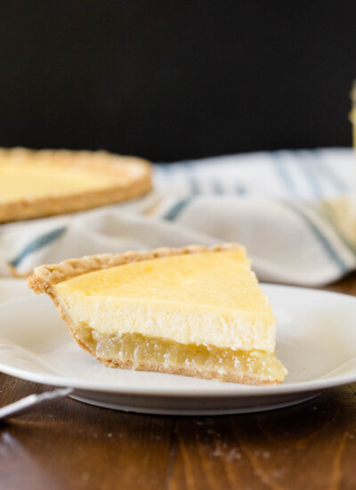 Pineapple Pie - A creamy, tropical pie with a twist. This easy dessert is filled with cream cheese, vanilla, and pineapple chunks!