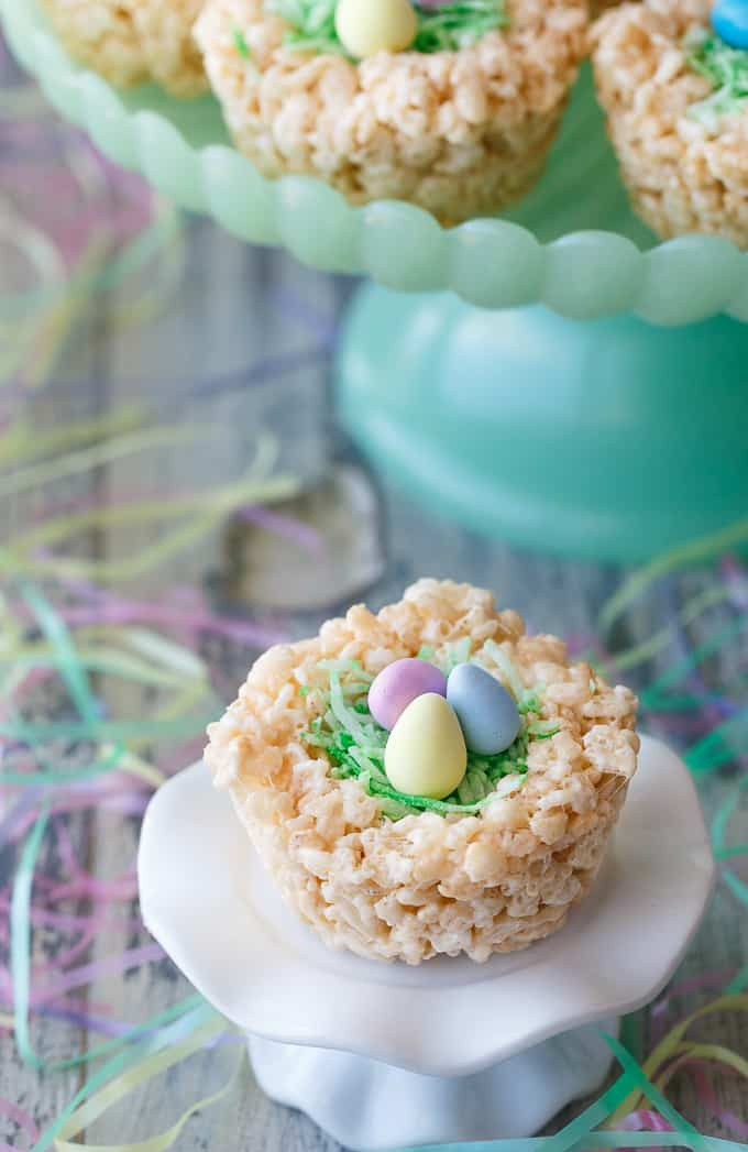 Krispie Easter Nests - This easy Easter dessert is fun to make and eat! Kids love to help decorate with colourful green grass and Easter chocolate and candy.
