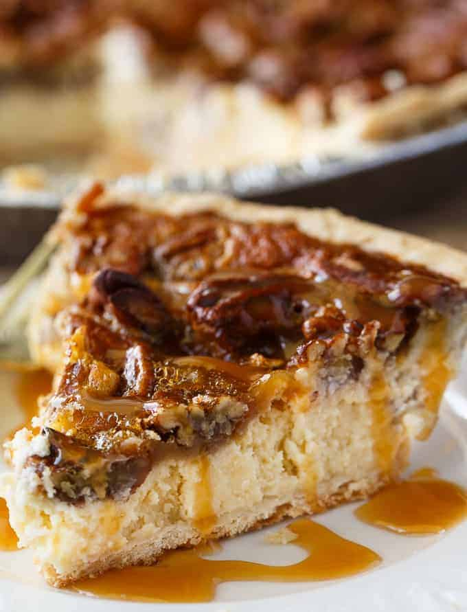 Pecan Pie Cheesecake - Creamy cheesecake filling is topped by a sweet layer of caramel pecans. This easy dessert recipe is one for the record books!