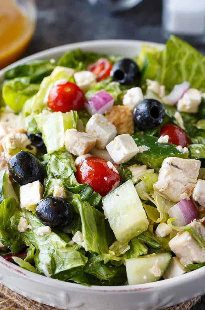 Greek Chicken Salad - This delicious salad is a meal on its own! It's loaded with chicken, fresh veggies, black olives, feta cheese and a Greek vinaigrette.