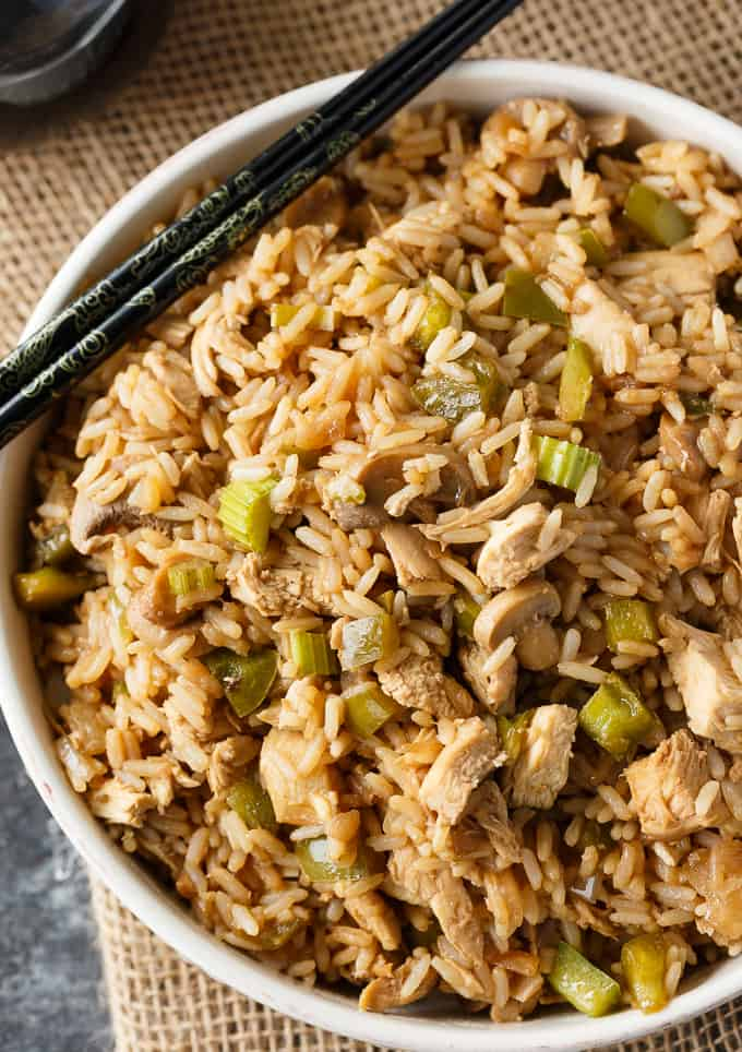 Chicken Fried Rice - Skip the takeout and make this homemade side dish! Tender rice is loaded with veggies, spices, and, of course, pieces of chicken in every bite. A must-make rice recipe.