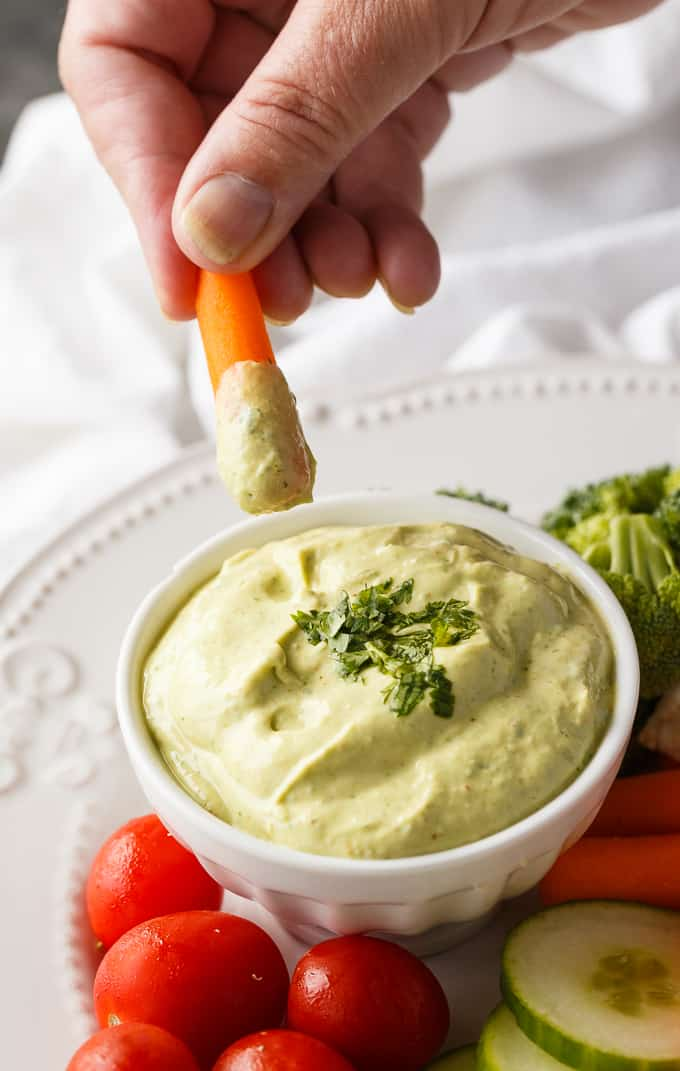 Cilantro Lime Avocado Yogurt Dip - This healthy veggie dip is as creamy as it is delicious! Packed with lime juice, Greek yogurt, avocado, cilantro, and a touch of chili powder.