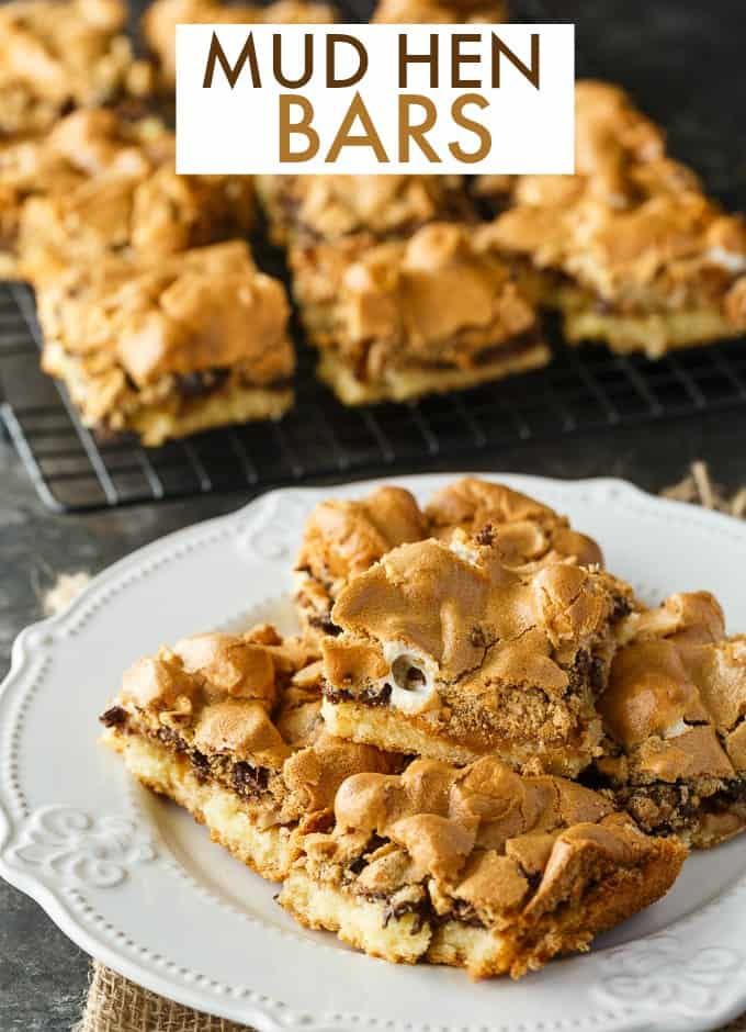 Mud Hen Bars - A vintage dessert from Grandma's cookbook. It has a cookie bar base, topped with a rich layer of walnuts, chocolate and melted marshmallows followed by a sweet brown sugar meringue topping.