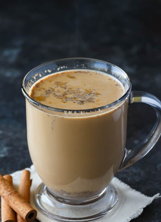 Slow Cooker Chai Latte - Sweet and spicy! This cozy drink is perfect for cold nights curled up with a good book.