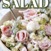 Christmas Salad - Contains all the colors of Christmas! This fresh, bright salad is made with broccoli, cauliflower, red onion and cherry tomatoes mixed with a creamy dressing.