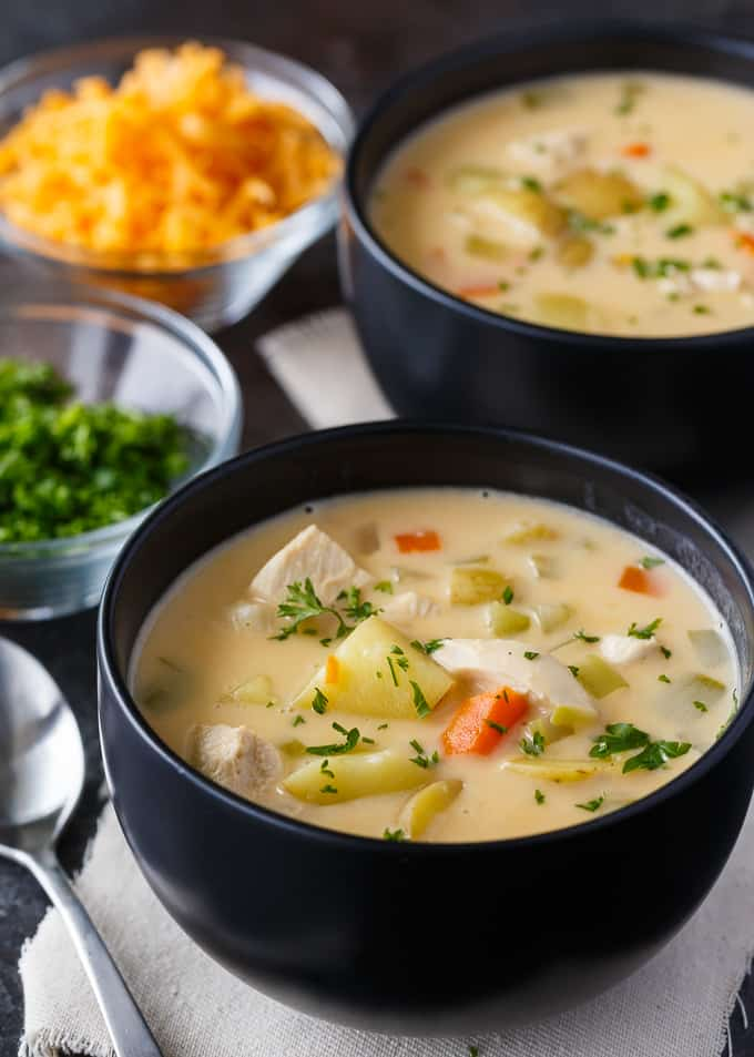 Cheesy Chicken Chowder - Hearty and delicious! This creamy chowder is loaded with chicken, potatoes, carrots and lots of cheese.