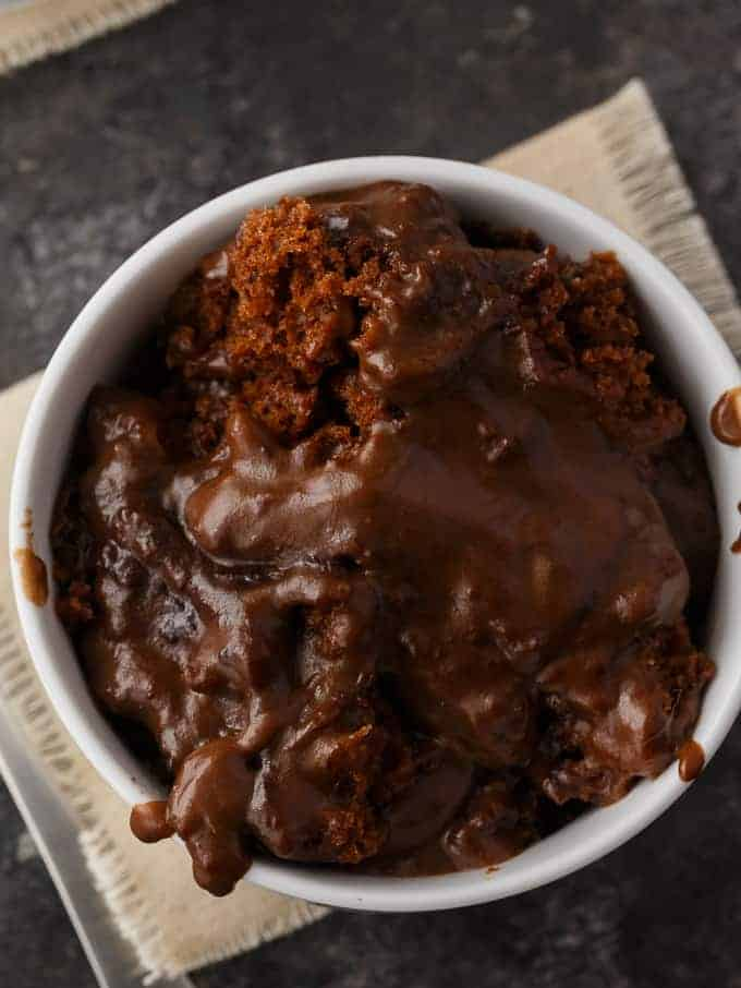 Hot Fudge Pudding Cake - So sinfully rich! Luscious chocolate cake bakes right with a creamy, chocolatey pudding sauce.