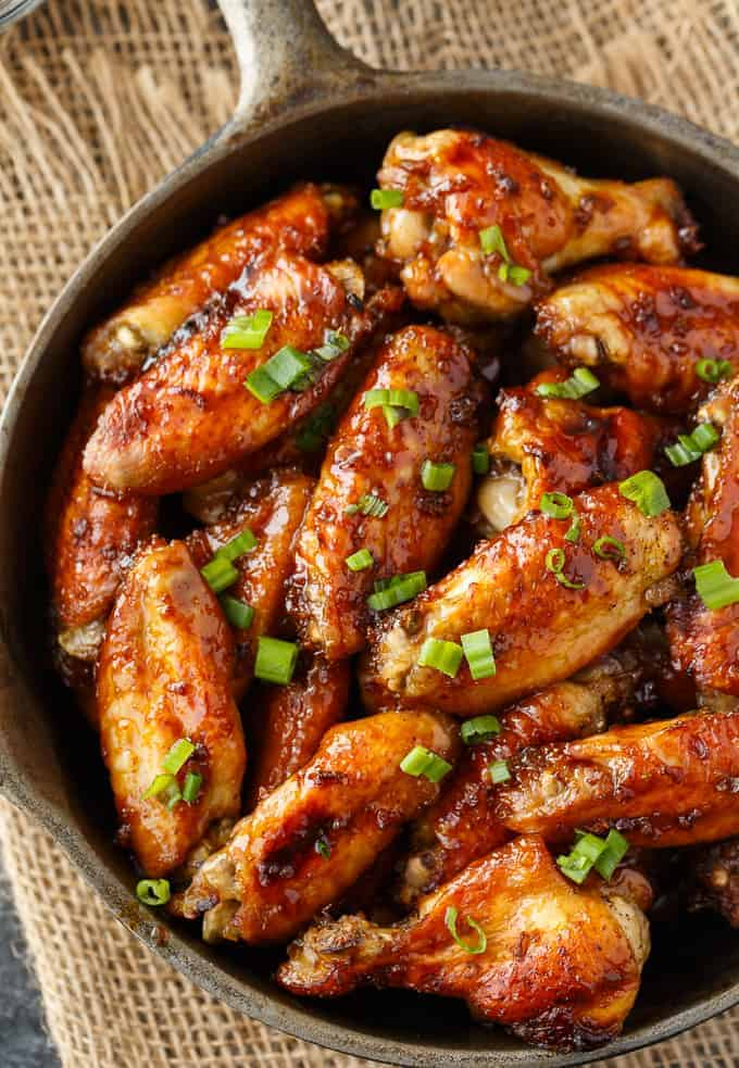 Oven Baked Chicken Wings - The BEST wing recipe ever! Juicy chicken wings are oven baked in a flavorful honey garlic sauce.