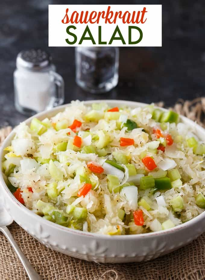 Sauerkraut Salad - Tangy and sweet! This delicious salad recipe has crisp veggies, sauerkraut tossed in a sweet dressing. Delish!