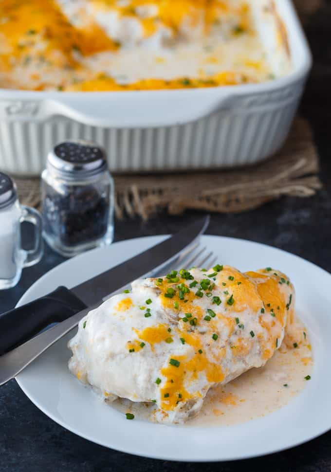 Sour Cream Chicken Bake - Creamy, cheesy comfort food. This easy chicken casserole is smothered in a rich sour cream sauce and loads of cheddar cheese.