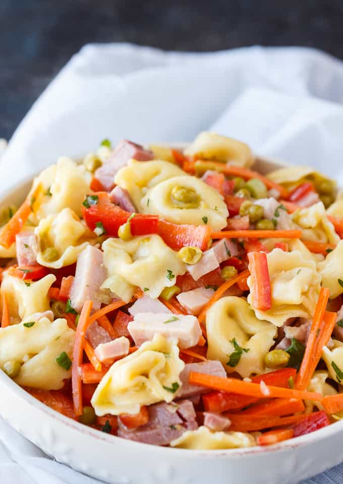 Tortellini Salad - This colorful pasta salad is packed full of flavor with tender pieces of ham, cheese tortellini and fresh, crisp veggies. Serve it at spring and summer parties!