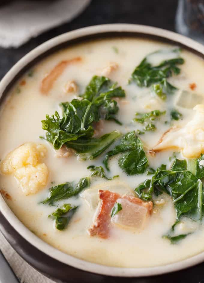 Keto Zuppa Toscana - A keto friendly version of the famous Tuscan soup! It's filled with kale, bacon, sausage, roasted cauliflower immersed in a creamy broth.