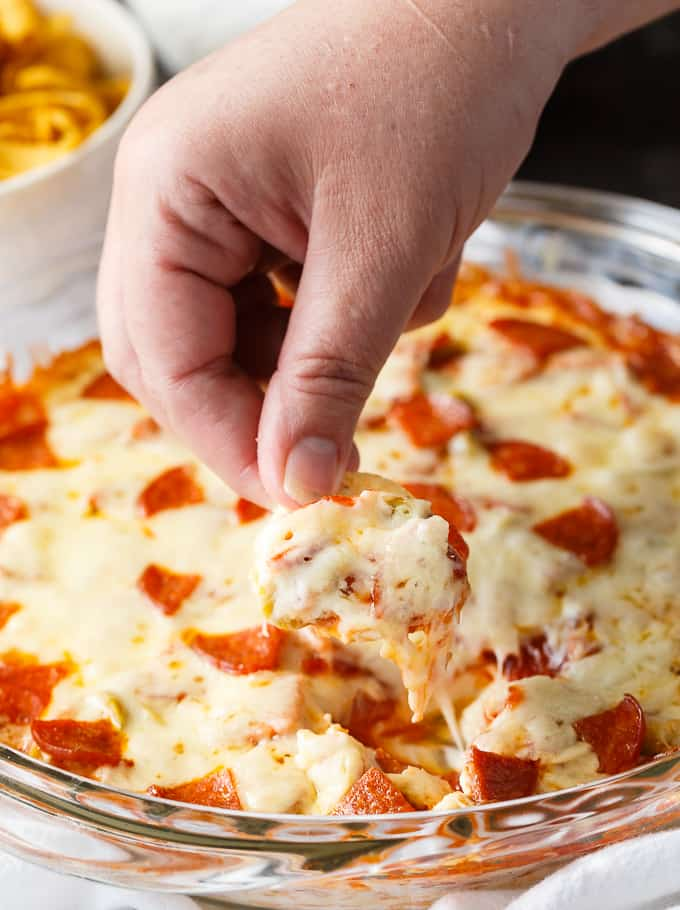 Pizza Dip - If you love pizza, you are going to LOVE this hot dip appetizer. Layers of cream cheese, pizza sauce, melty mozzarella cheese and your favorite pizza toppings make this dip a surefire hit.