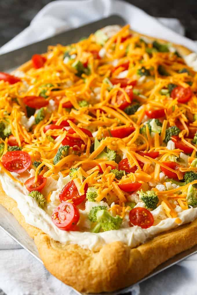 Vegetable Pizza - This easy appetizer is perfect for parties and potlucks. It's made with crescent roll dough, ranch dressing mix and loads of fresh, crispy veggies. Yum!