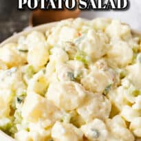 Cheese Potato Salad - Who doesn't love cheese?! Add some to this BBQ side dish with hard boiled eggs, green olives, celery, and green onions.