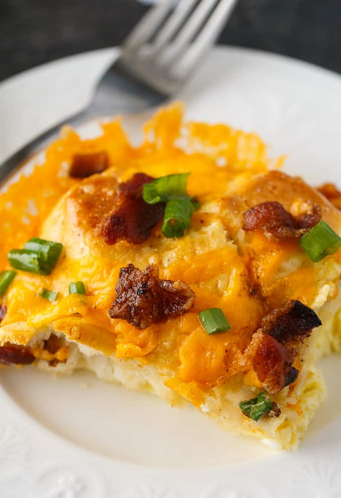 Bacon and Egg Biscuit Casserole - An easy breakfast casserole recipe made with eggs, bacon and biscuits. It's super easy to whip up and can be made the night before and kept in the fridge.
